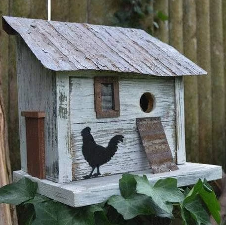 A birdhouse designed to resemble a chicken coop.