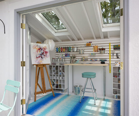 A garden shed that's been converted into an art studio