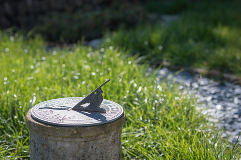 A sundial in the grass