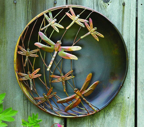 Dragonfly wall decor in a metal finish.
