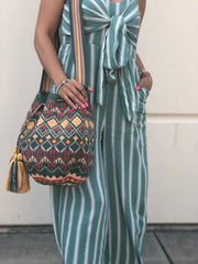 Wearing a olive Premium Wayuu Bag