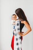 A beautiful black, white and grey gingham plaid ring sling with matte black rings. Junior Foxes handmade baby carriers in Toronto, Canada