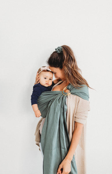 the fauna ring sling, mossy green with gold rings. Junior Foxes Baby carriers handmade in Toronto Canada