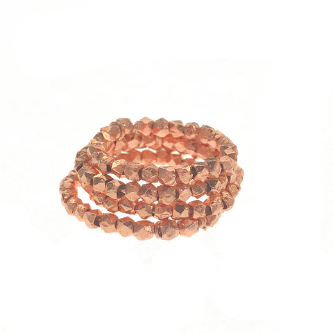 a stack of rose gold midi rings