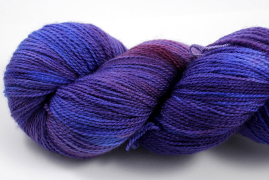 Kettle dyed, tonal yarn in cobalt blue, dark violet, amethyst, and ruby red.  Hand dyed in New Jersey.  Shown on Plush Fingering, our 100% superwash merino wool yarn.  Perfect for shawl, scarves, and sweaters!
