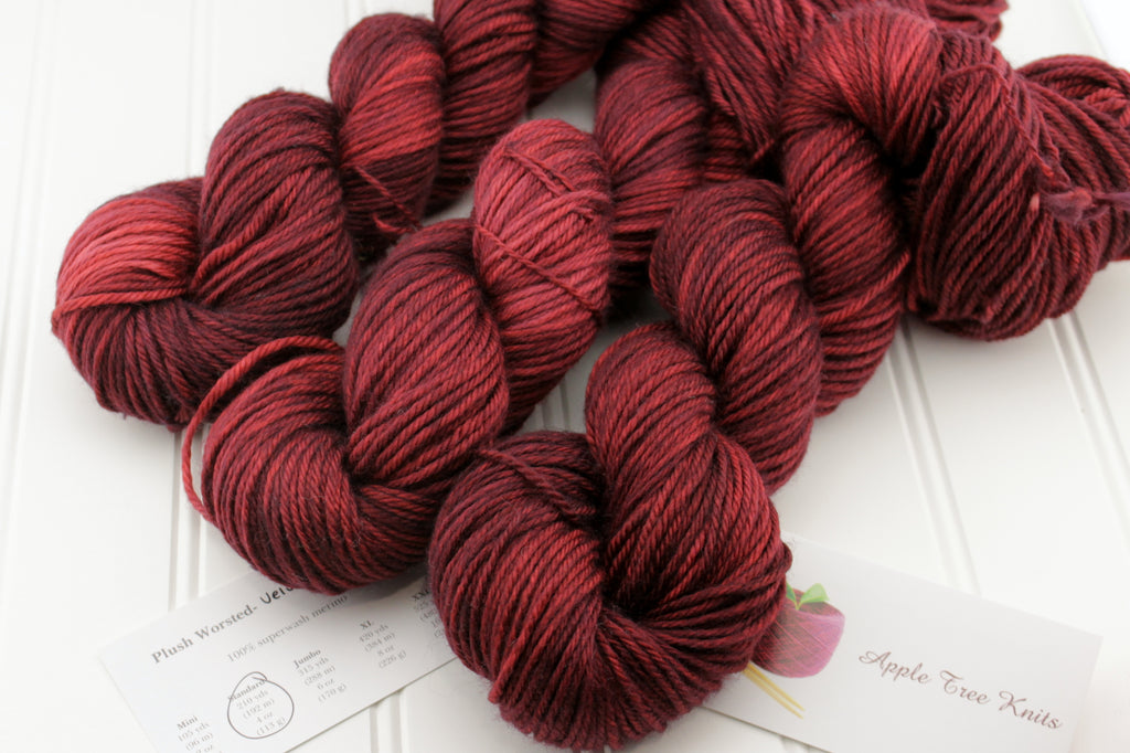 Hand dyed yarn in oxblood red, shown on our Plush Worsted yarn: 100% superwash merino.  Available dyed to order on any of our 13 luxurious yarns, including silk, merino, linen, and more!