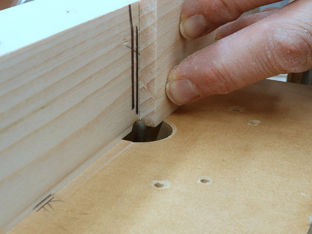 Using the router bit to cut a woodhinge groovel for his woodhinge