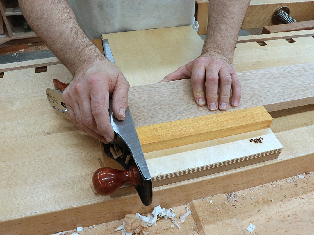 Rob Cosman using a shooting board to square the end of a piece of stock