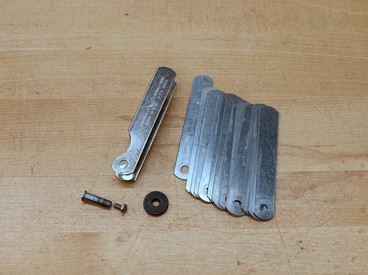 Feeler gauge with nut removed
