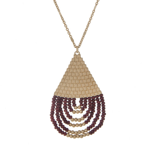 Gold necklace with burgundy teardrop pendant