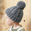 Beechfield Toddler Cable Knit Beanie Hat Worn by Boy B480A