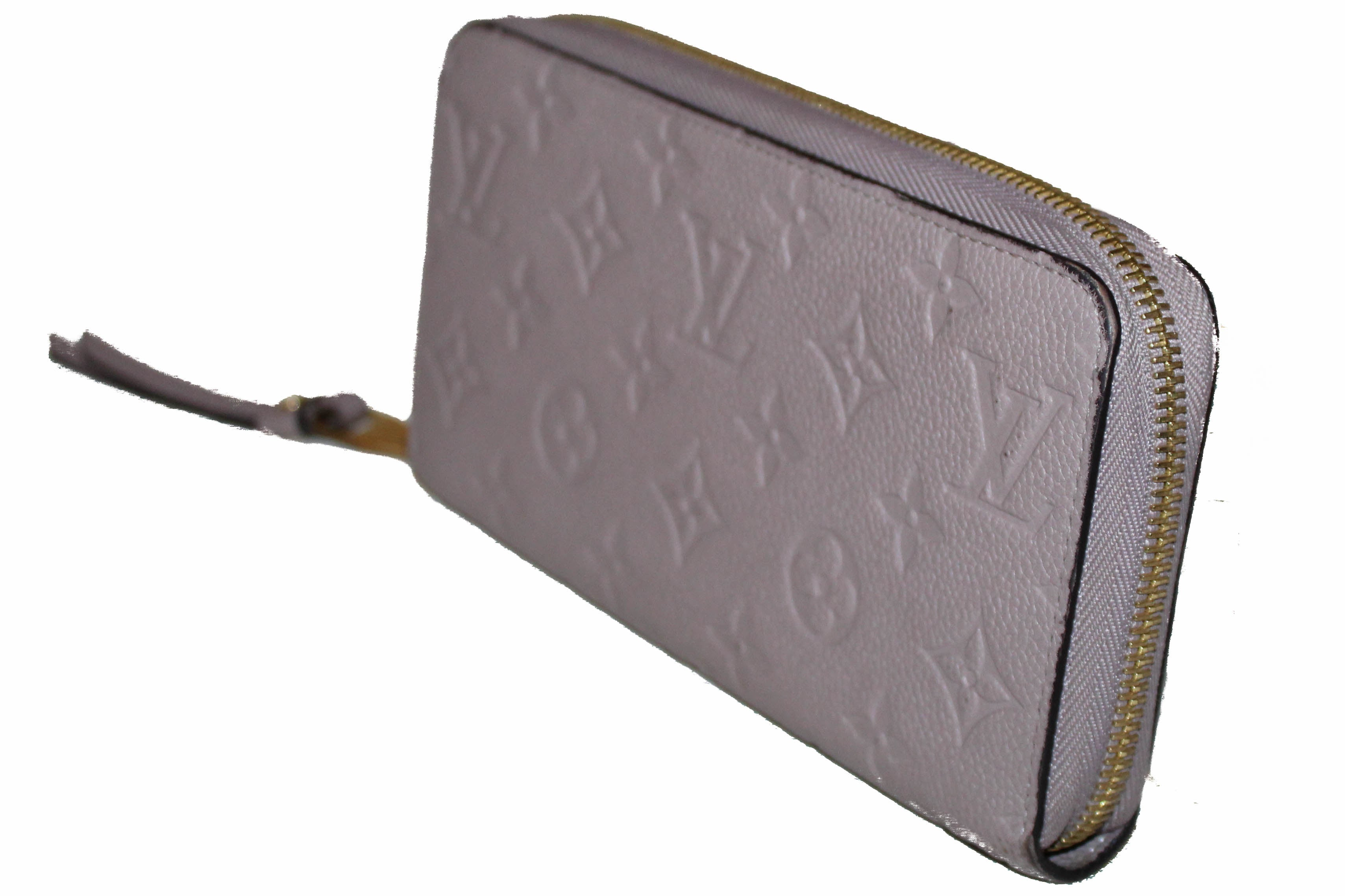 Authentic Louis Vuitton Mastic Monogram Empreinte Leather Zippy Wallet