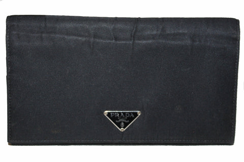 0fd35f78257b Authentic Prada Black Nylon Flap Wallet ...