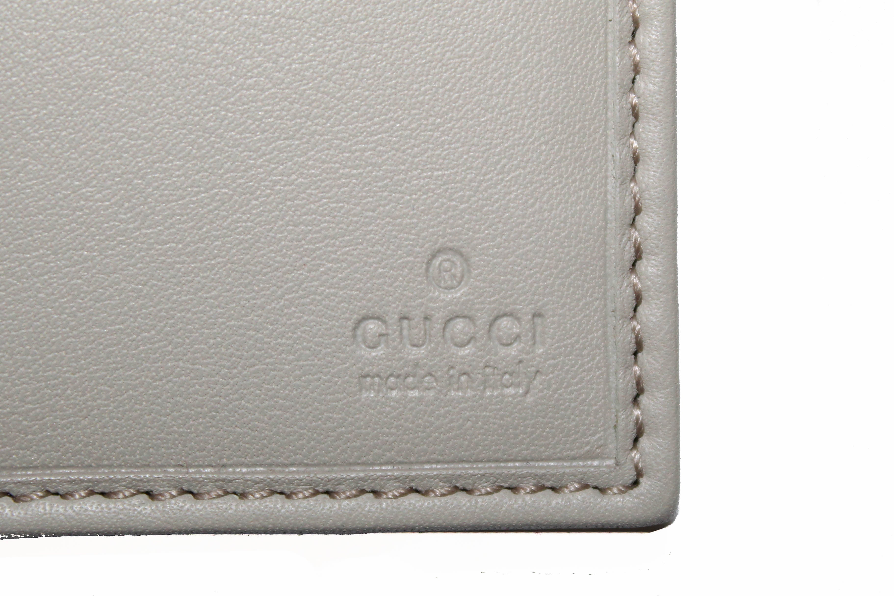 Authentic Gucci Ivory Guccissima Leather D-Ring Long Wallet