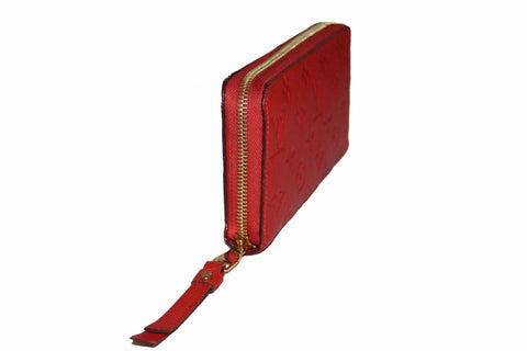 Authentic Louis Vuitton Orange Red Orient Monogram Empreinte Leather Zippy Wallet