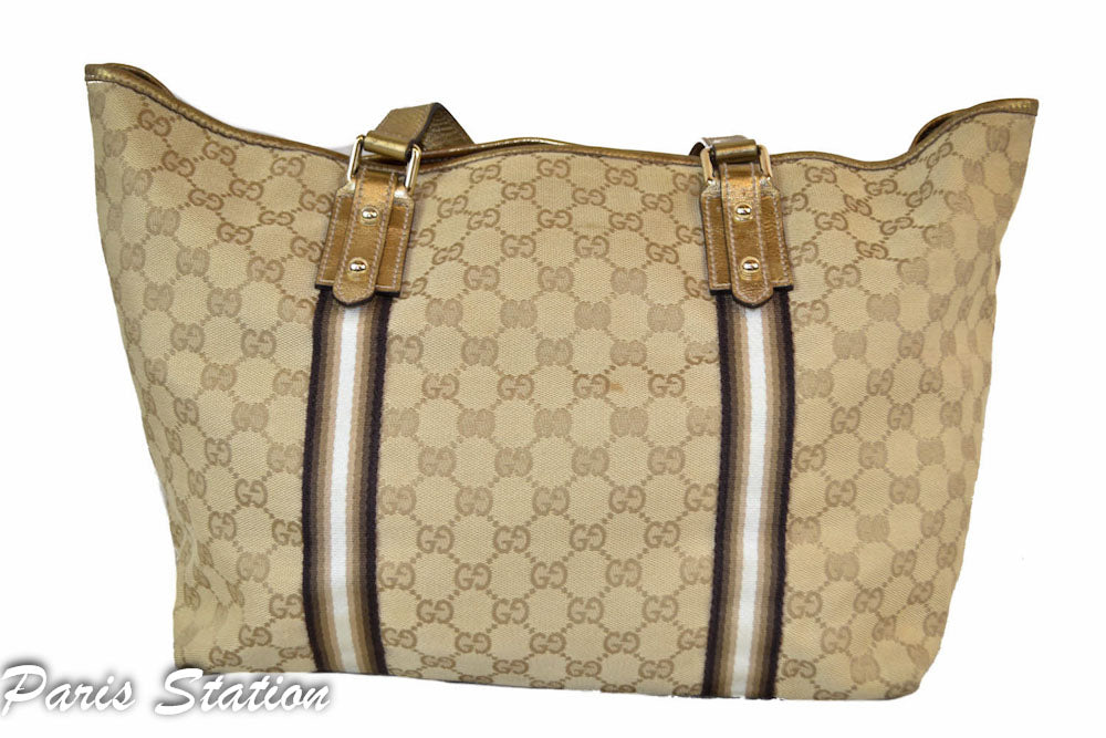 bede1ca1b088 Authentic Gucci Gold GG Canvas Heart Charm Shoulder Bag – Paris ...