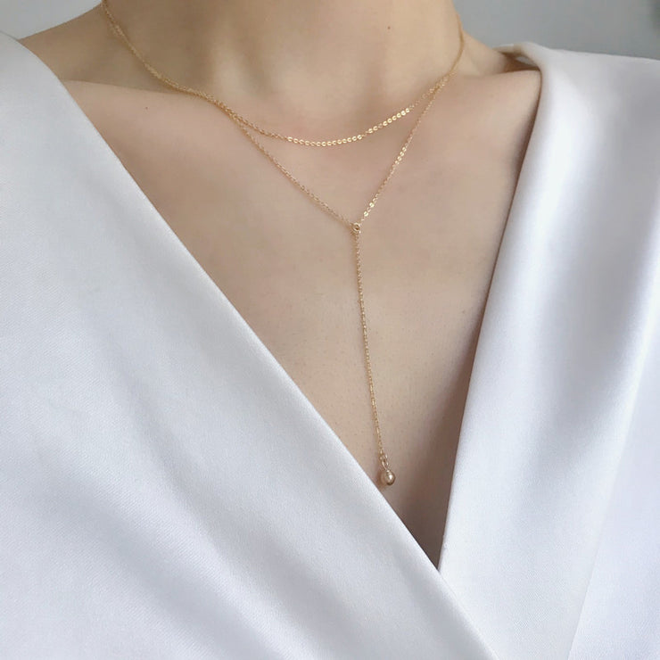 DOUBLE LAYERED GLOBE NECKLACE