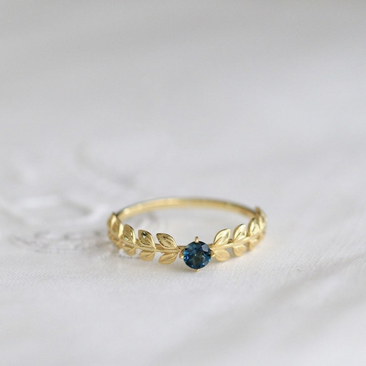 OLIVE BRANCH BLUE TOPAZ RING