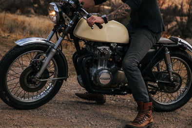 Motorcycle | Metal Fashion | Alternative Fashion | What is Batterskull | Man in biker boot's on hiw motorcycle