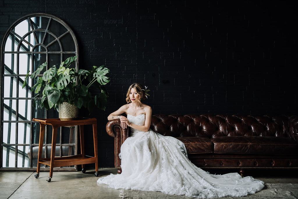 Bloc Venue Styled Shoot | Photos @CariCourtright | Jewelry @coreyegan | Planning @SayYesEventCo | Venue and Furniture @blocvenue | Florals @alicia.voelkerdesign | Hair & Makeup @camillegoldston_hair_makeup | Cake @mapetitiemaisoncakedesign | Dress @kinsleyjamescouturebridal | Jumpsuit @asos | Linens @LaTavola | Votives @glassybaby | Tabletop rentals @standardpartyrentals |  Models @rencallaghan @alitzagarcia |Assistant @sweetsorayasantos