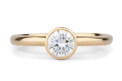 Round Bezel Set Solitaire with Moissanite in Yellow Gold