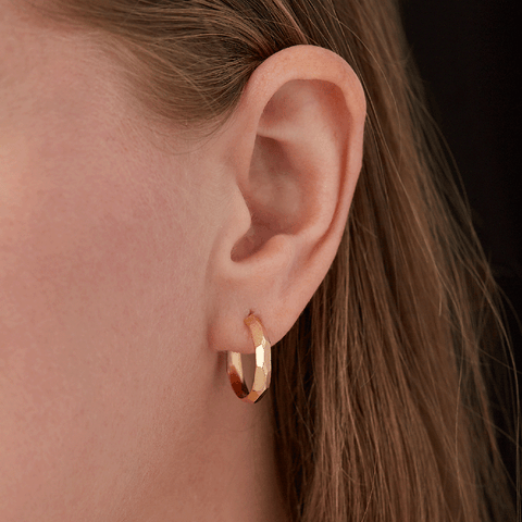 Small faceted yellow gold hoop earrings