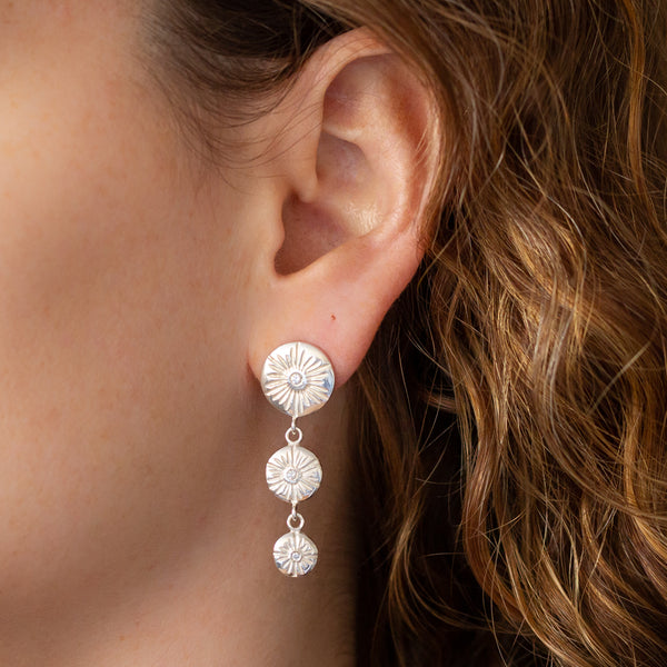 Silver and diamond three-drop statement earrings