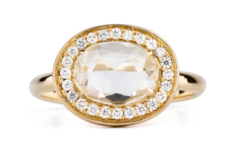 Oval white rose cut sapphire halo ring in yellow gold