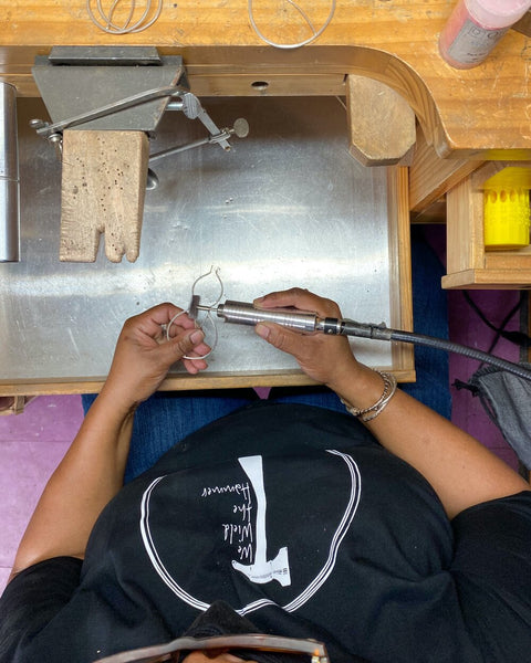 Karen Smith of We Wield the Hammer creating jewelry at her workbench