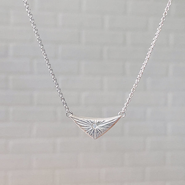 Sterling silver flash necklace a triangle shape with a diamond center