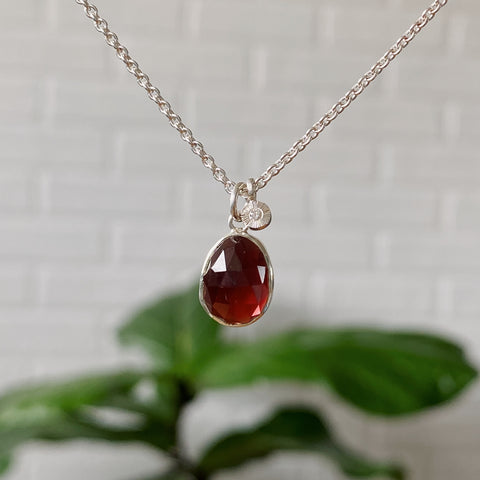 Rose cut mozambique garnet bezel pendant with an engraved diamond pendant cluster in silver