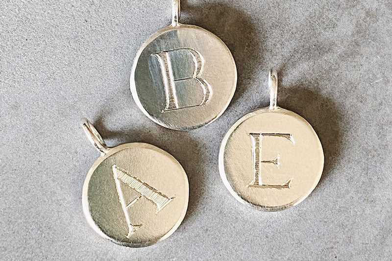 Initial Pendants in silver with engraved block letter