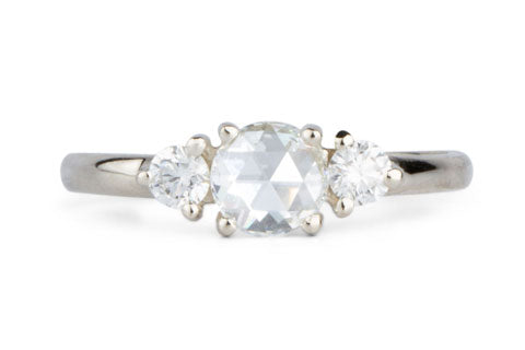 Three stone prong setting ring with rose cut diamond in white golg