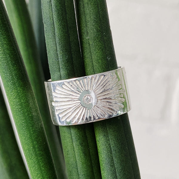Sterling silver beacon band with a white diamond center