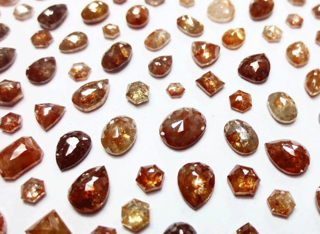 Reddish color rustic diamonds in a variety of rose cut shapes