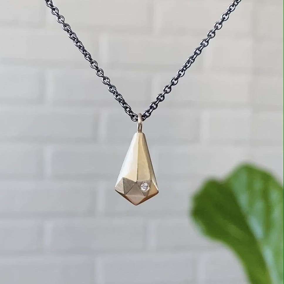 14k yellow gold faceted fragment pendant with a single diamond on an oxidized silver chain. by Corey Egan