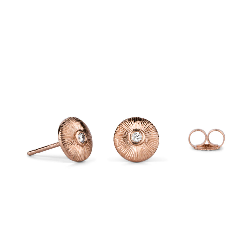 Round rose gold engraved stud earrings with diamond centers by Corey Egan