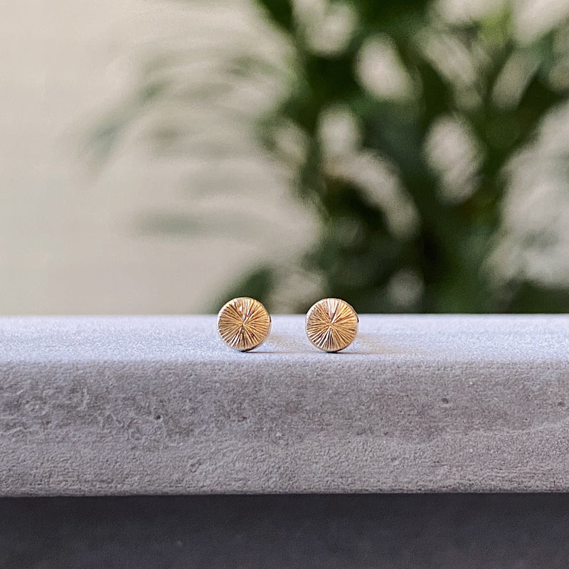 Tiny engraved gold stud earring by Corey Egan