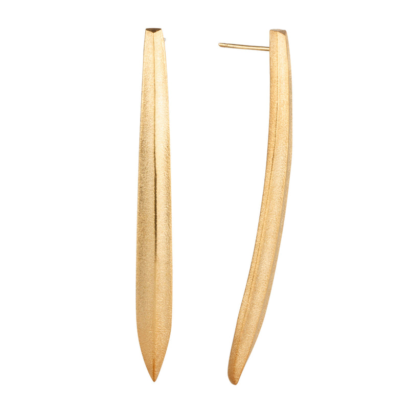 Long curved and pointed gold vermeil stud earrings by Corey Egan