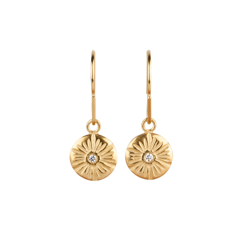 Medium round sunburst dangle earrings with a diamond center in gold vermeil by Corey Egan