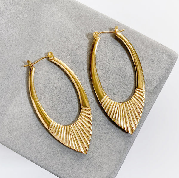 Gold Vermeil Large Oblong hoops with hinge closure and sunburst bottom by Corey Egan