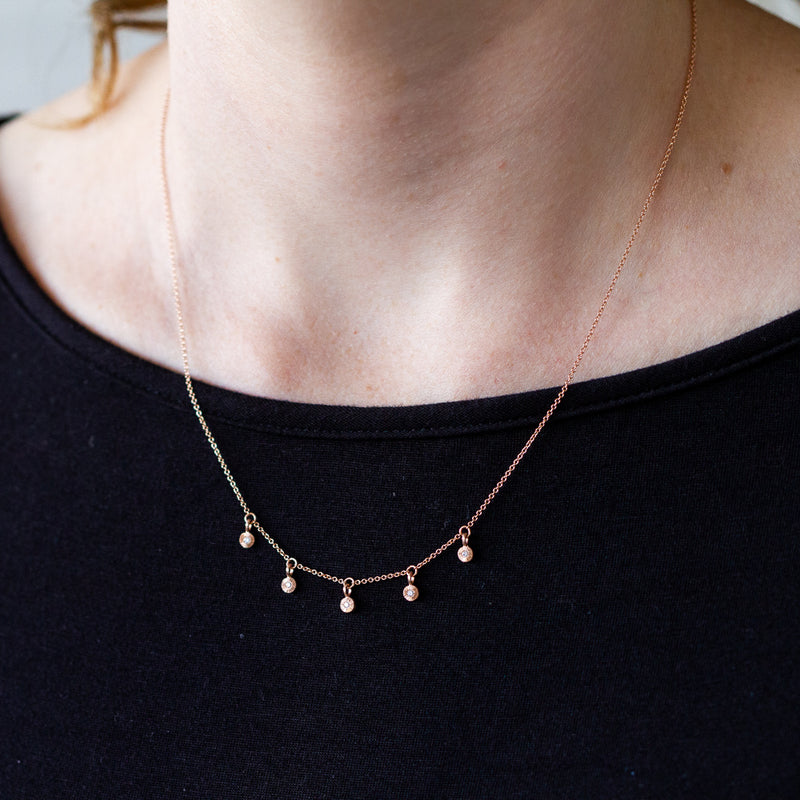14k rose gold and diamond Rise station necklace by Corey Egan