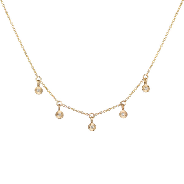 Gold and diamond station necklace with five tiny engraved pendants with diamond centers