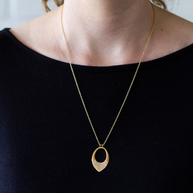 "Gold vermeil medium open petal shape pendant with a textured bottom on a 22"" silver chain"