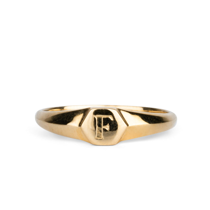 "Low profile gold signet ring with hexagon top and engraved single block ""F"" initial"