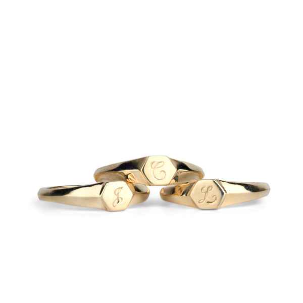 Low profile gold signet ring with hexagon top and engraved single script initial