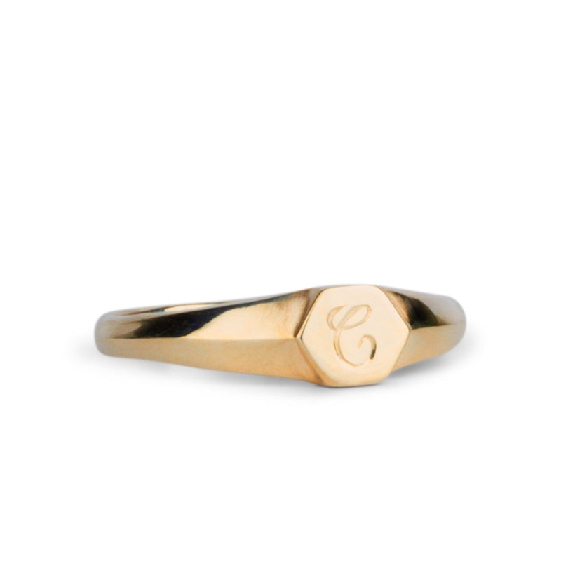 "Low profile gold signet ring with hexagon top and engraved single script ""C"" initial"
