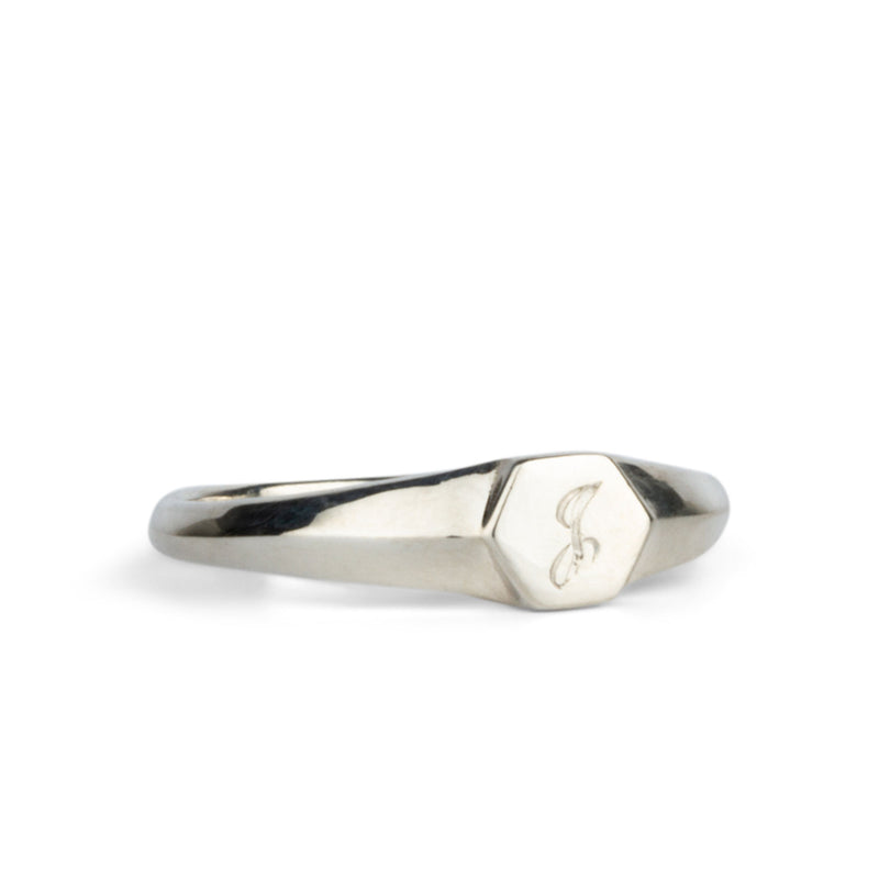 "Low profile sterling silver signet ring with hexagon top and engraved single script ""J"" initial"