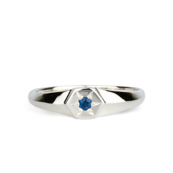 silver signet ring with sapphire in star setting
