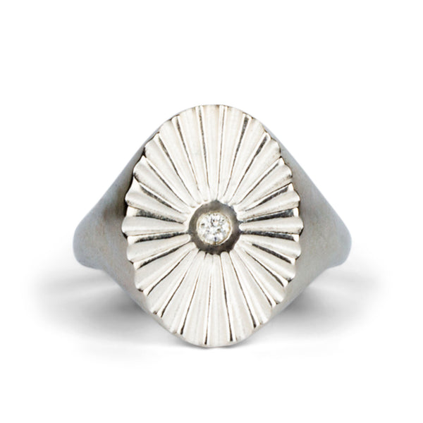 silver oval sunburst signet ring with a diamond center
